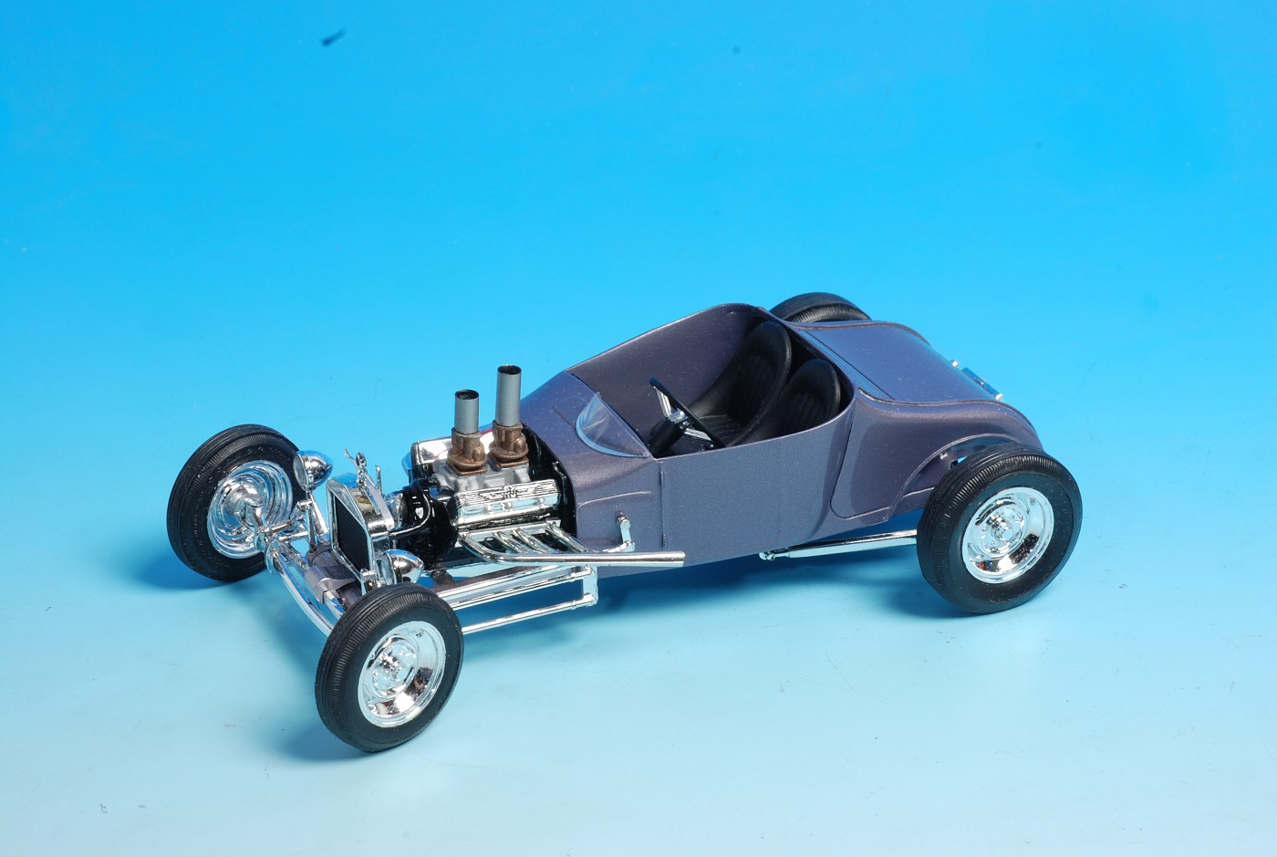 I used a monogram little t 25 model t roadster chassis which was patterned after model a frame rails and a thorougly kitbashed ford y block engine